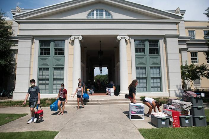"""Students move in at the University of South Carolina. <p class=""""copyright""""><a href=""""https://www.gettyimages.com/search/photographer?family=editorial&photographer=Sean+Rayford"""" rel=""""nofollow noopener"""" target=""""_blank"""" data-ylk=""""slk:Sean Rayford/Getty Images"""" class=""""link rapid-noclick-resp"""">Sean Rayford/Getty Images</a></p>"""