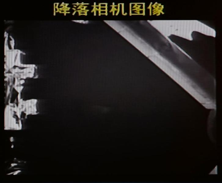 This screen grab taken from CCTV live broadcasting footage shows an image of China's first lunar rover transmitted back to the control centre in Beijing, after it landed on the moon on December 14, 2013