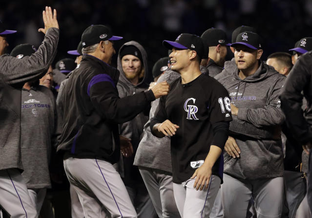Colorado Rockies relief pitcher Seunghwan Oh, second from right, of South Korea, celebrates with manager Bud Black after the Rockies defeated the Chicago Cubs 2-1 in the National League wild-card playoff baseball game Tuesday, Oct. 2, 2018, in Chicago. (AP Photo/Nam Y. Huh)