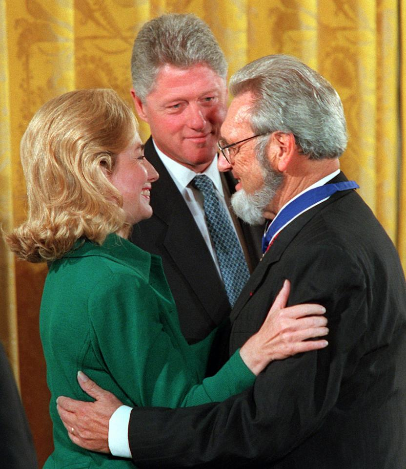 President Clinton looks on as first lady Hillary Rodham Clinton hugs former U.S. Surgeon General C. Everett Koop at the White House Friday, Sept. 29, 1995, after Koop received a Presidential Medal of Freedom. (AP Photo/Ron Edmonds)
