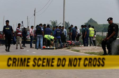 Crime Scene Unit works on the spot where police shot dead a suspected militant, who tried to enter a security check post on a motorcycle armed with explosives in Khilgaon outskirt of Dhaka