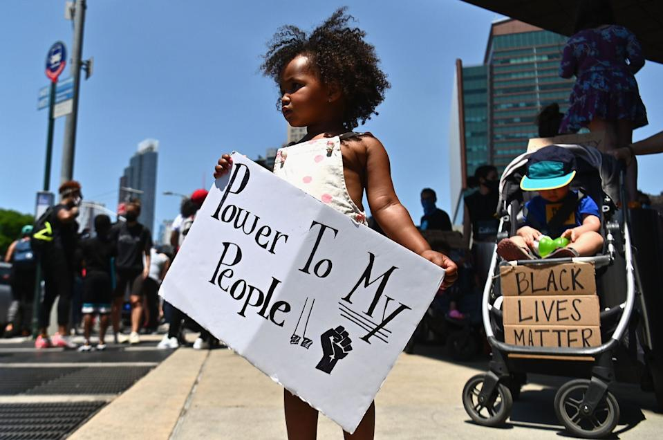 Families participate in a children's march in solidarity with the Black Lives Matter movement and national protests against police brutality on June 9, 2020 in the Brooklyn, New York.
