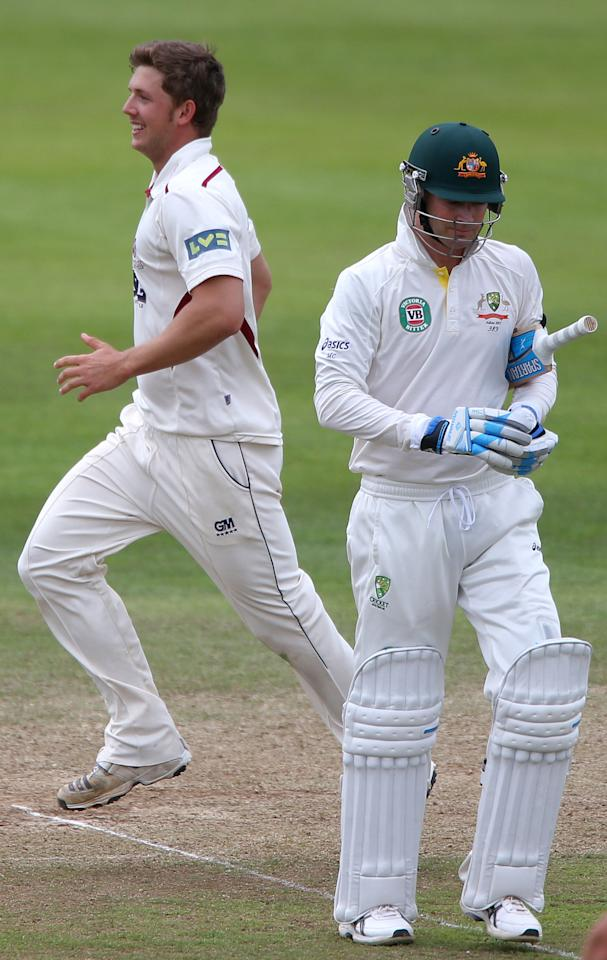 Australia's Michael Clarke shows his dejection after he was out for 45 as Somerset bowler Craig Meschede celebrates, during the International Tour match at the County Ground, Taunton.