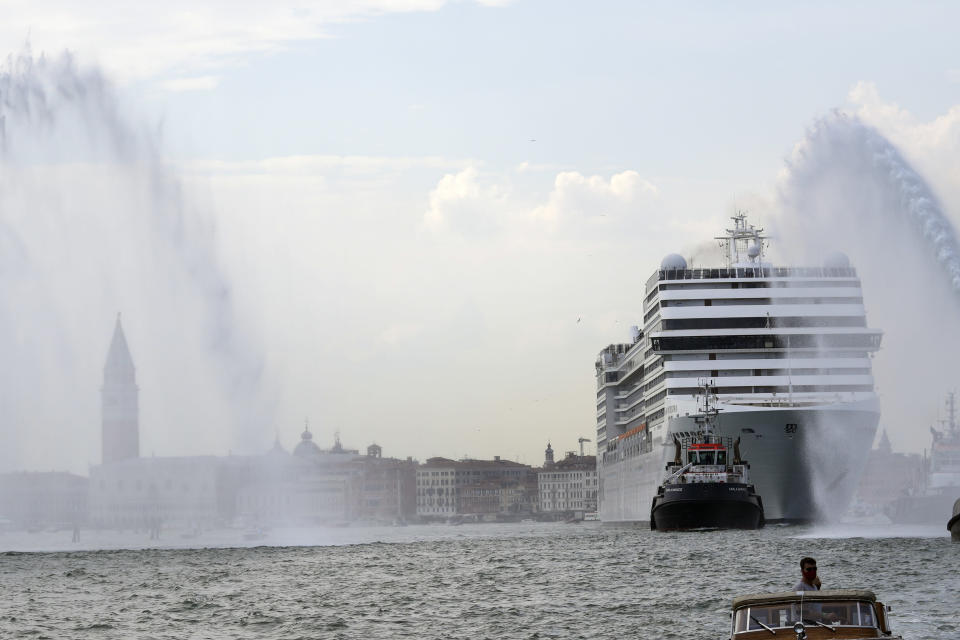 The MSC Orchestra cruise ship leaves Venice, Italy, Saturday, June 5, 2021. The 92,409-ton, 16-deck MSC Orchestra cruise ship, the first cruise ship leaving Venice since the pandemic, departed Saturday amid protests by activists demanding that the enormous ships be permanently rerouted out the fragile lagoon, especially Giudecca Canal through the city's historic center, due to environmental and safety risks. The ship passed two groups of protesters: pro-cruise advocates whose jobs depend on the industry as well as protesters who have been campaigning for years to get cruise ships out of the lagoon. (AP Photo/Antonio Calanni)