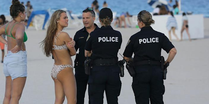 College students talking to the Miami Beach police in Florida on March 14.