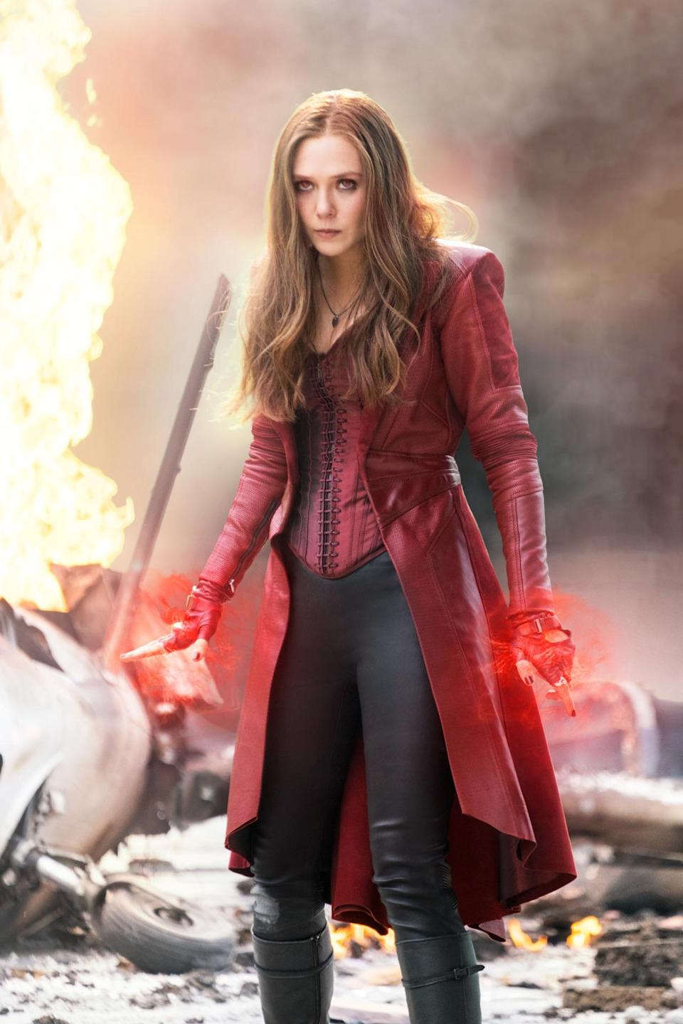 <p>The youngest Avenger is still struggling with her potent abilities — not to mention the death of her twin brother and destruction of her homeland. It's Wanda's inability to control her powers that triggers the tragic accident that sets <i>Civil War</i> in motion. <i>(Photo: Disney)</i></p>