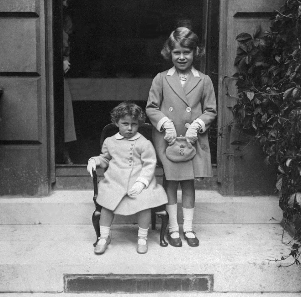 Elizabeth, future Queen, at about seven, in 1933, on the right. Younger sister Margaret Rose is with her. (Getty Images)