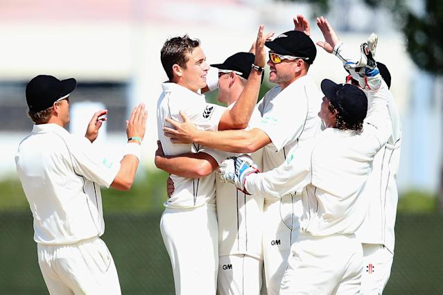 DUNEDIN, NEW ZEALAND - DECEMBER 06: Tim Southee of New Zealand celebrates the wicket of Marlon Samuels of the West Indies with his team during day four of the first test match between New Zealand and the West Indies at University Oval on December 6, 2013 in Dunedin, New Zealand. (Photo by Hannah Johnston/Getty Images)