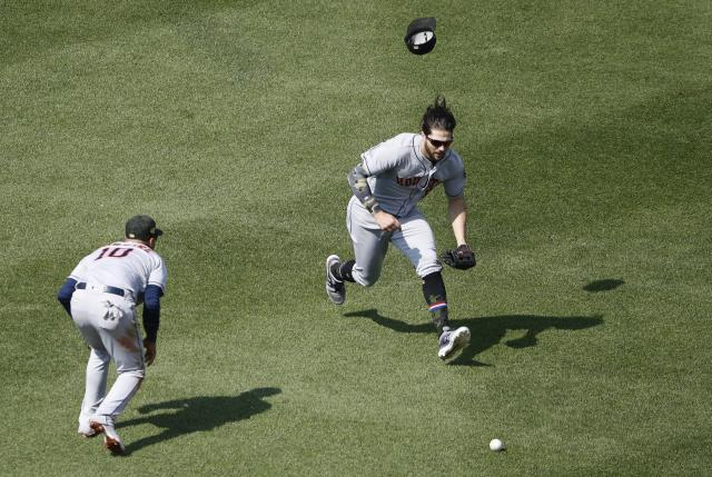 A single by Boston Red Sox's Xander Bogaerts falls between Houston Astros' Yuli Gurriel (10) and Jake Marisnick during the fifth inning of a baseball game Sunday, May 19, 2019, at Fenway Park in Boston. (AP Photo/Winslow Townson)