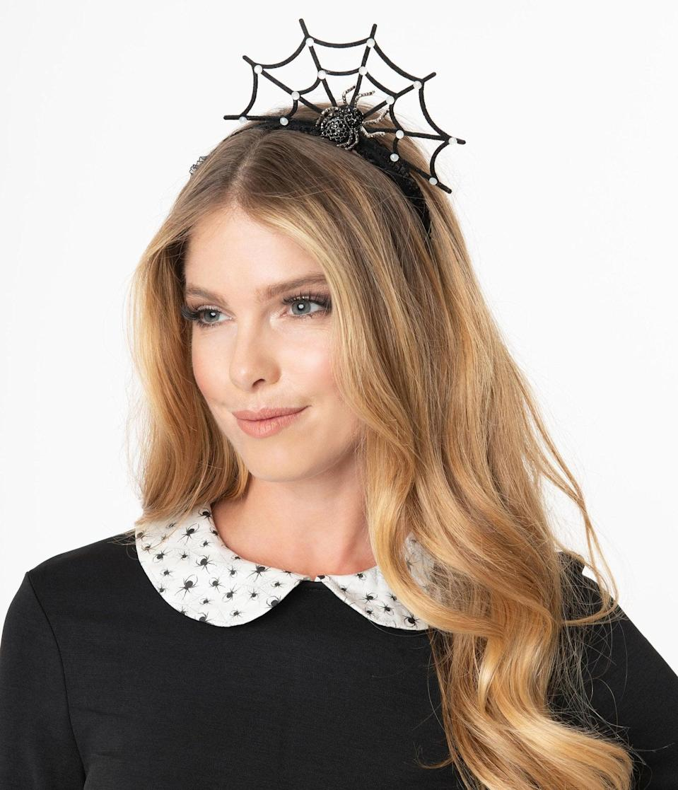 <p>The <span>Black Rhinestone Spider and Web Headband</span> ($38) will take any outfit up a notch. </p>