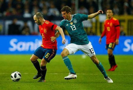 Soccer Football - International Friendly - Germany vs Spain - ESPRIT arena, Dusseldorf, Germany - March 23, 2018 Spain's Andres Iniesta in action with Germany's Thomas Mueller REUTERS/Thilo Schmuelgen