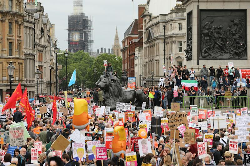 """Anti-Trump protesters and the """"Trump Baby"""" blimp in central London. (Photo: Isabel Infantes/AFP/Getty Images)"""