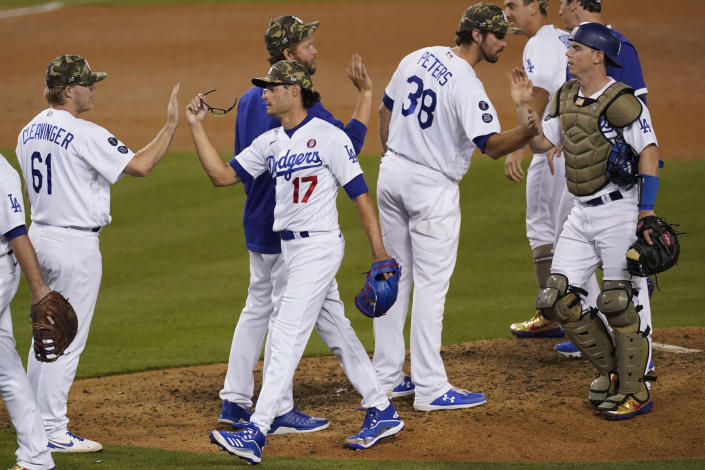 The Los Angeles Dodgers celebrate after a 7-0 win over the Miami Marlins in a baseball game Saturday, May 15, 2021, in Los Angeles. (AP Photo/Ashley Landis)