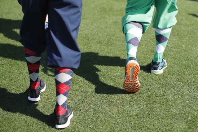 Golf patrons sport colorful socks as they attend the second day of practice for the 2018 Masters golf tournament at Augusta National Golf Club in Augusta, Georgia, U.S. April 3, 2018. REUTERS/Mike Segar
