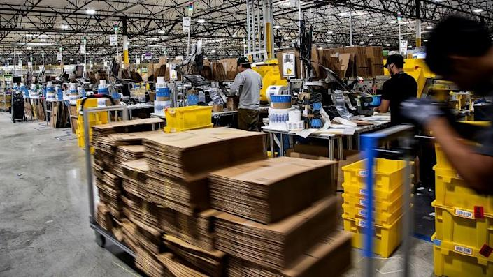 Workers quickly pack items on Cyber Monday at the Amazon Fulfillment Center on November 28, 2016 in San Bernardino, California.