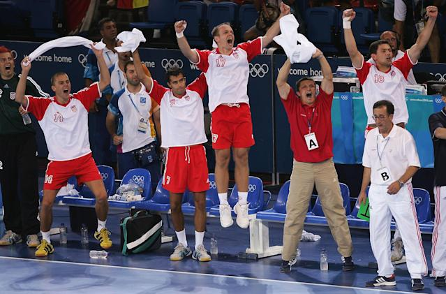 ATHENS - AUGUST 29: The Croatian bench celebrate after scoring a goal in the men's handball gold medal match between Gemany and Croatia on August 29, 2004 during the Athens 2004 Summer Olympic Games at the Faliro Coastal Zone Olympic Complex Sports Pavilion in Athens, Greece. (Photo by Doug Pensinger/Getty Images)