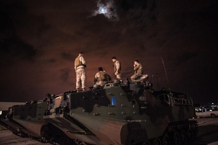 Charlie Company of the 4th Assault Amphibious Battalion, Marine Forces Reserve arrive at the Central Mall in Port Arthur, TX on Thursday night after running rescue missions in the hardest hit areas of town throughout the day.