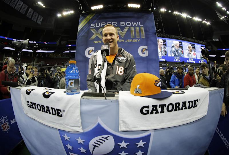 Denver Broncos' Peyton Manning answers questions during media day for the NFL Super Bowl XLVIII football game Tuesday, Jan. 28, 2014, in Newark, N.J. (AP Photo/Matt Slocum)