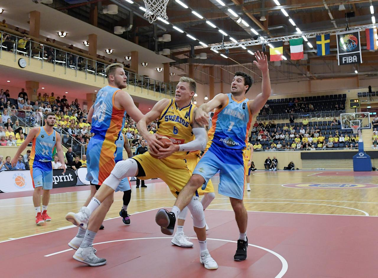 Sweden's Viktor Gaddefors is stopped by Armenia's Andrew Chrabascz during the European basketball Pre-Qualifers Group A between Sweden and Armenia at IFU Arena in Uppsala, Sweden August 16, 2017. TT News Agency/Photo Janerik Henriksson/via REUTERS ATTENTION EDITORS - THIS IMAGE WAS PROVIDED BY A THIRD PARTY. SWEDEN OUT. NO COMMERCIAL OR EDITORIAL SALES IN SWEDEN.