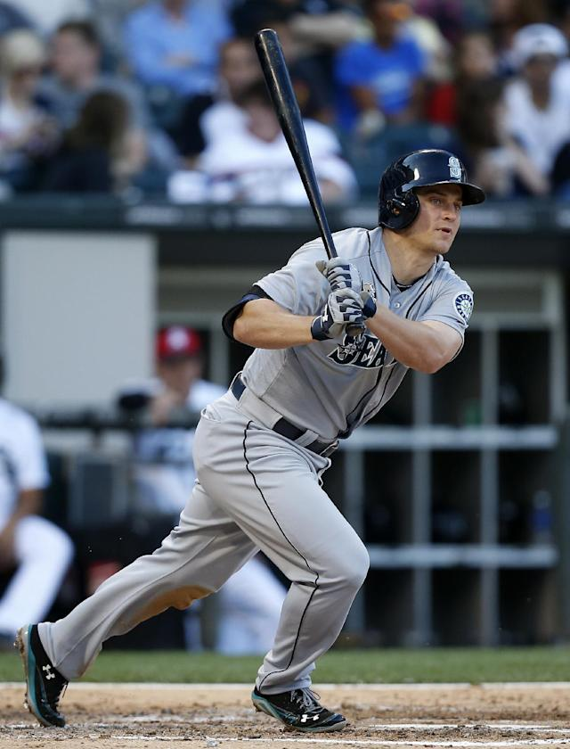 Seattle Mariners' Kyle Seager watches as he grounds out against the Chicago White Sox during the fifth inning of a baseball game on Friday, July 4, 2014, in Chicago. (AP Photo/Andrew A. Nelles)