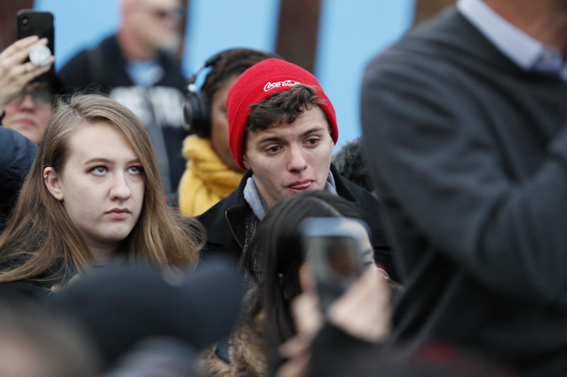 Supporters for Democratic presidential candidate Beto O'Rourke react while listening to him speak before the Iowa Democratic Party's Liberty and Justice Celebration, Friday, Nov. 1, 2019, in Des Moines, Iowa. O'Rourke told his supporters that he was ending his presidential campaign. (AP Photo/Charlie Neibergall)