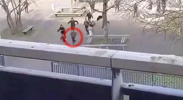 The man was captured on video running out of the school after being chased by a group of students. Source: LiveLeak