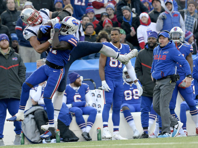 <p>New England Patriots tight end Rob Gronkowski, left, makes a catch as Buffalo Bills cornerback Tre'Davious White (27) defends during the second half of an NFL football game, Sunday, Dec. 3, 2017, in Orchard Park, N.Y. Bills head coach Sean McDermott, right, looks on during the play. (AP Photo/Adrian Kraus) </p>