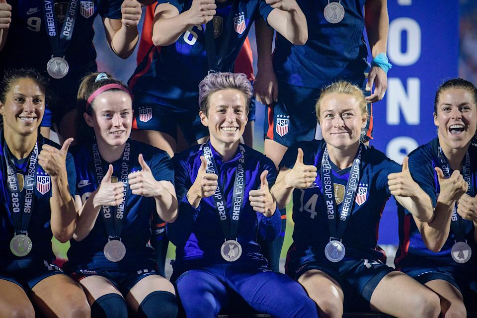 Megan Rapinoe and the USWNT celebrate after winning the 2020 SheBelieves Cup.