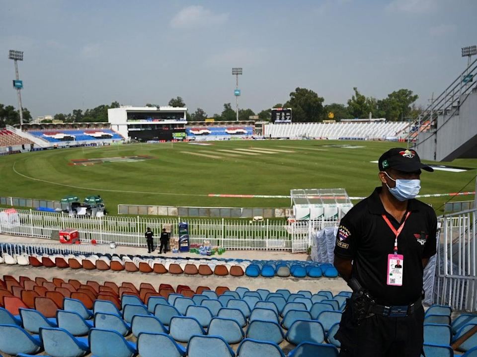 A policeman stands guard on the empty stands of the Rawalpindi Cricket Stadium in Rawalpindi (AFP)