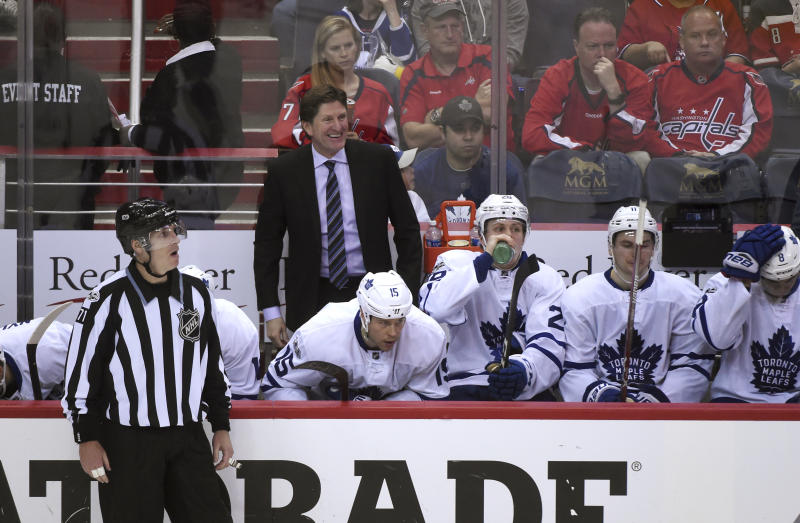 Toronto Maple Leafs coach Mike Babcock smiles from the bench during the first overtime period against the Washington Capitals in Game 2 of an NHL Stanley Cup first round playoff series in Washington, Saturday, April 15, 2017. Toronto won 4-3 in two overtimes. (AP Photo/Molly Riley)