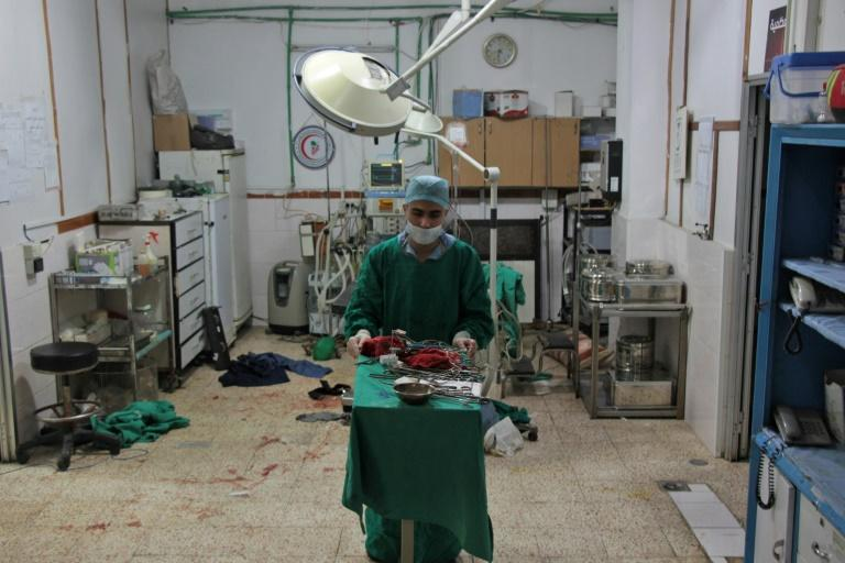 Once operations are over in Syria's rebel-held Douma, doctors re-sterilise their gloves and surgical equipment so they can be used again
