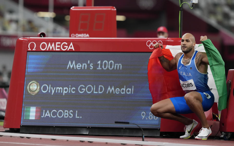 Lamont Marcell Jacobs, of Italy celebrates after winning the gold medal in the final of the men's 100-meters at the 2020 Summer Olympics, Sunday, Aug. 1, 2021, in Tokyo, Japan. (AP Photo/Martin Meissner)