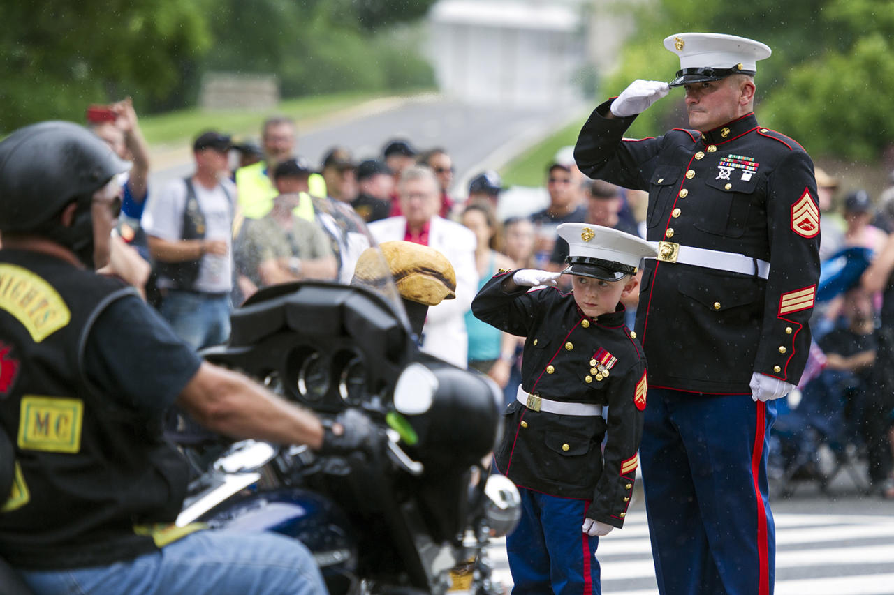 "<p>Motorcyclists pass Marine Staff Sgt. Tim Chambers, Ret., and Christian Jacobs, 6, of Hertford, N.C., as they salute during the 30th anniversary of the Rolling Thunder ""Ride for Freedom"" demonstration in Washington, Sunday, May 28, 2017. Jacobs father, Marine Sgt. Christopher Jacobs, was killed while serving in 2011. Rolling Thunder seeks to bring full accountability for all U.S. prisoners of war and missing in action soldiers. (Photo: Cliff Owen/AP) </p>"