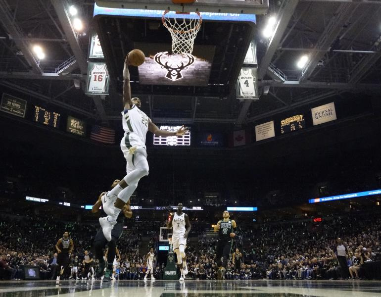 Milwaukee Bucks' Khris Middleton shoots during the first half of Game 4 of an NBA basketball first-round playoff series against the Boston Celtics Sunday, April 22, 2018, in Milwaukee. (AP Photo/Morry Gash)