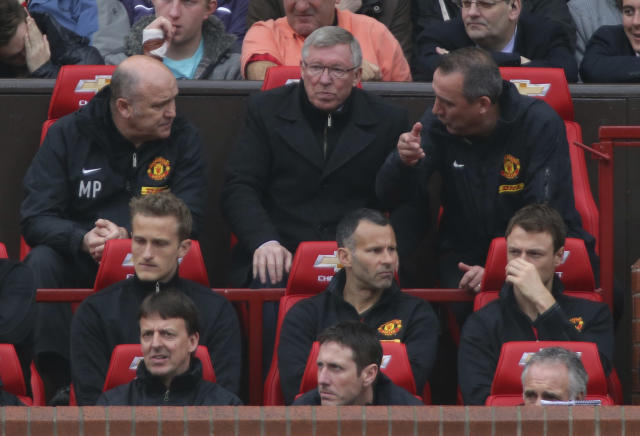 MANCHESTER, ENGLAND - MAY 12: Manager Sir Alex Ferguson of Manchester United watches from the dugout during the Barclays Premier League match between Manchester United and Swansea at Old Trafford on May 12, 2013 in Manchester, England. (Photo by John Peters/Man Utd via Getty Images)