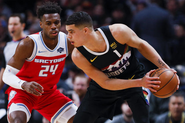 Kings guard Buddy Hield (24) defends Nuggets forward Michael Porter Jr. (1) in the first half Sunday in Denver. (AP Photo/Joe Mahoney)
