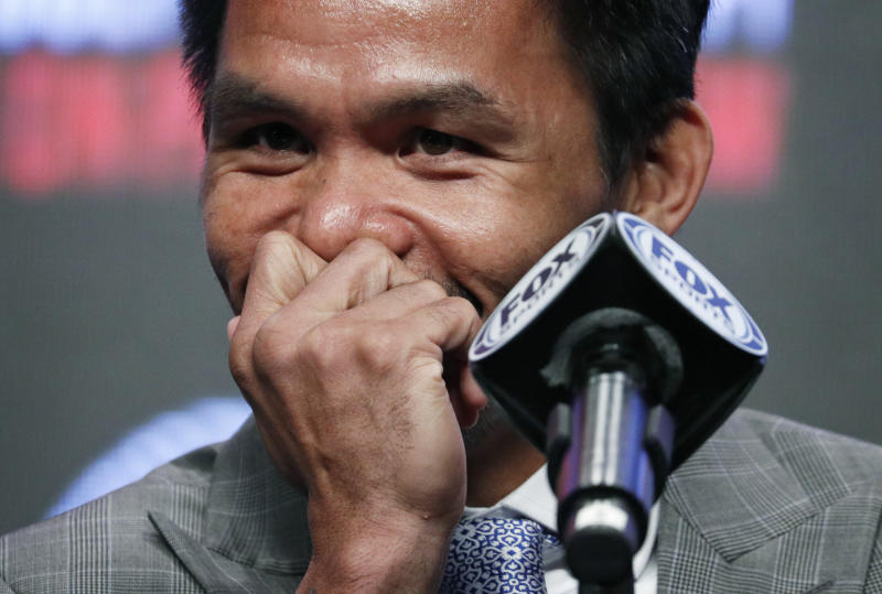 Manny Pacquiao laughs during a news conference Wednesday, July 17, 2019, in Las Vegas. Pacquiao is scheduled to fight Keith Thurman in a welterweight championship boxing match Saturday in Las Vegas. (AP Photo/John Locher)