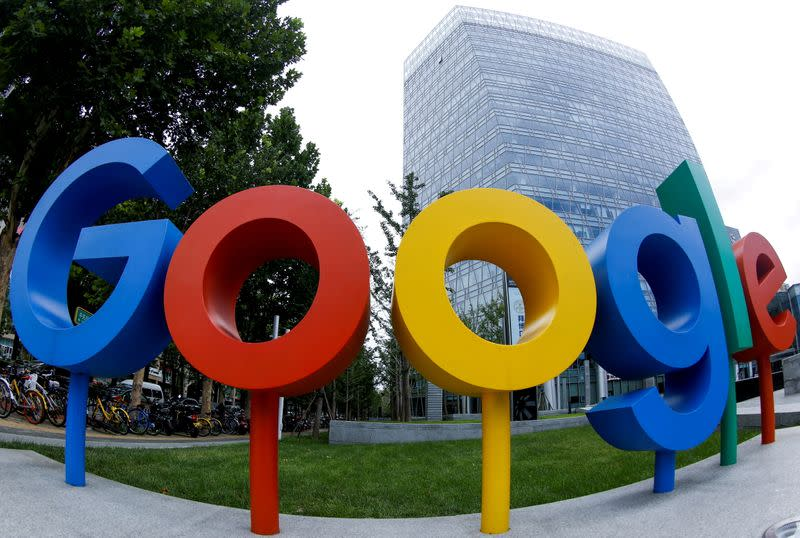 FILE PHOTO: The brand logo of Alphabet Inc's Google is seen outside its office in Beijing, China