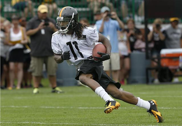 Pittsburgh Steelers wide receiver Markus Wheaton (11) runs after making a catch during practice at NFL football training camp in Latrobe, Pa., Sunday, July 27, 2014. (AP Photo/Keith Srakocic)