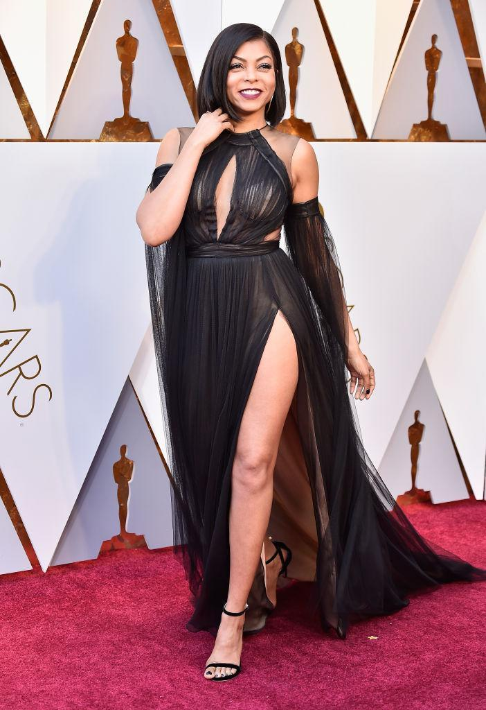 <p>Henson worked a black chiffon gown with a thigh-high leg slit. (Photo by Frazer Harrison/Getty Images) </p>