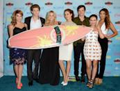 """Cast members, from left, Ashley Benson, Keegan Allen, Sasha Pieterse, Troian Bellisario, Ian Harding, Janel Parrish and Shay Mitchell pose backstage with the award for choice TV show: drama for """"Pretty Little Liars"""" at the Teen Choice Awards at the Gibson Amphitheater on Sunday, Aug. 11, 2013, in Los Angeles. (Photo by Jordan Strauss/Invision/AP)"""