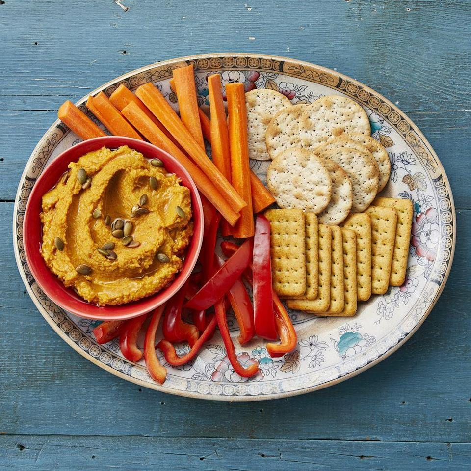 """<p>Protein-packed hummus is a popular dip that's made even better with the addition of pumpkin puree, roasted garlic, and pumpkin pie spice. Serve it as a Thanksgiving appetizer with raw veggies. </p><p><a href=""""https://www.thepioneerwoman.com/food-cooking/recipes/a34418144/sunny-anderson-easy-roasted-garlic-pumpkin-hummus/"""" rel=""""nofollow noopener"""" target=""""_blank"""" data-ylk=""""slk:Get the recipe."""" class=""""link rapid-noclick-resp""""><strong>Get the recipe. </strong></a></p><p><a class=""""link rapid-noclick-resp"""" href=""""https://go.redirectingat.com?id=74968X1596630&url=https%3A%2F%2Fwww.walmart.com%2Fsearch%2F%3Fquery%3Dpioneer%2Bwoman%2Bserving%2Bplatters&sref=https%3A%2F%2Fwww.thepioneerwoman.com%2Ffood-cooking%2Fmeals-menus%2Fg37022645%2Fhealthy-pumpkin-recipes%2F"""" rel=""""nofollow noopener"""" target=""""_blank"""" data-ylk=""""slk:SHOP SERVING PLATTERS"""">SHOP SERVING PLATTERS</a></p>"""