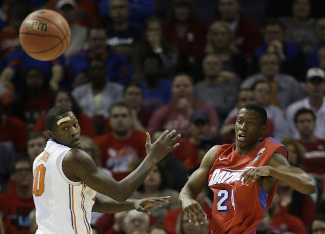 Dayton guard Jordan Sibert (24) and Florida forward Dorian Finney-Smith (10) watch a passed ball during the first half in a regional final game at the NCAA college basketball tournament, Saturday, March 29, 2014, in Memphis, Tenn. (AP Photo/Mark Humphrey)