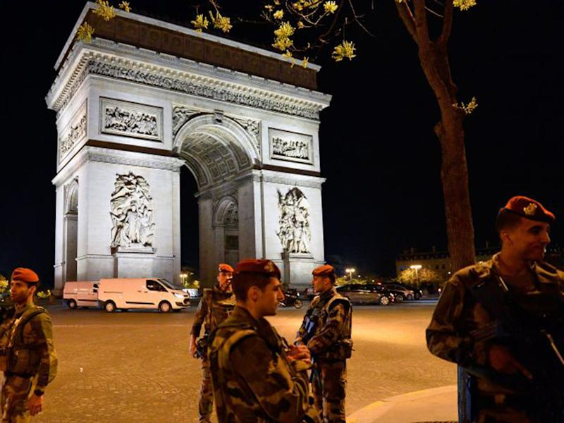 French military police secure the area near the Champs-Elysees yesterday: Getty