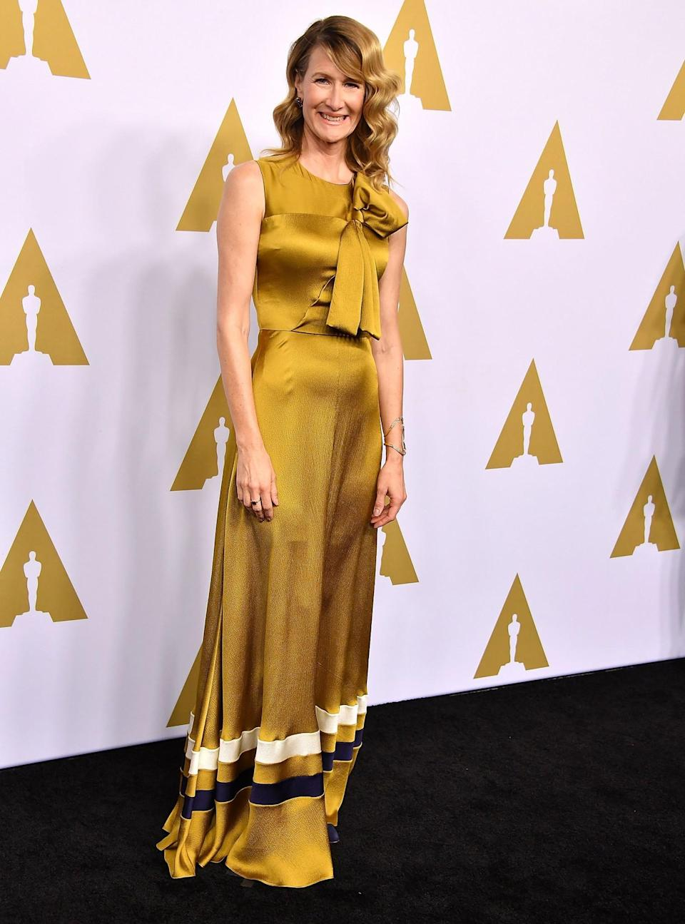 <p>Laura Dern was a vision in yellow, wearing a floor-length Roksanda number. [Photo: Getty] </p>