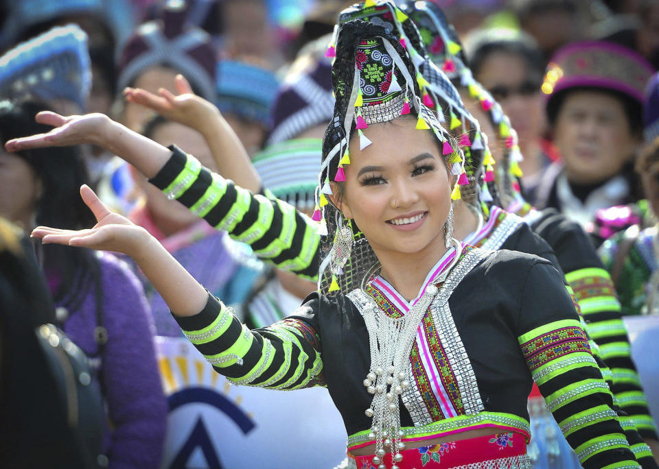 Kaitlyn Vang, 14, performs with her dance group during the parade kicking off the first day of the Hmong New Year celebration at the Fresno Fairgrounds, Thursday Dec. 26, 2019. (John Walker/The Fresno Bee via AP)