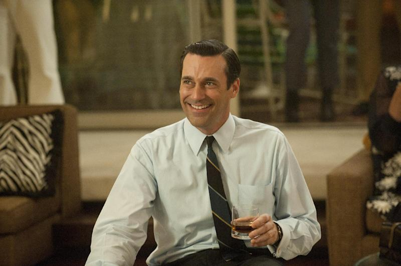 """In this publicity photo released by AMC, Jon Hamm as Don Draper is shown in Season 5, Episode 1, of """"Mad Men."""" The nominations for the 64th Primetime Emmy Awards are announced on Thursday, July 19, 2012. """"Mad Men"""" is making a bid at Emmy Awards history to win its fifth best drama series trophy. (AP Photo/AMC, Ron Jaffe)"""