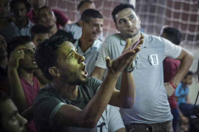 Egyptian fans watch the group A World Cup match between Egypt and Russia at a cafe in the hometown of Liverpool star striker Mohammed Salah, in the Nile delta village of Nagrig, Egypt, Tuesday, June 19, 2018. (AP Photo/Islam Safwat)