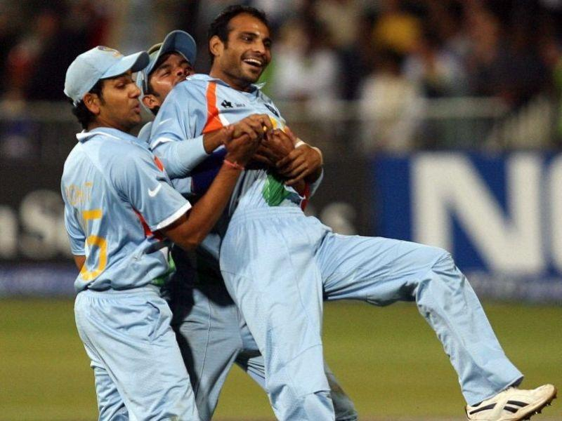 Joginder Sharma (R) is mobbed by his teammates after the final wicket