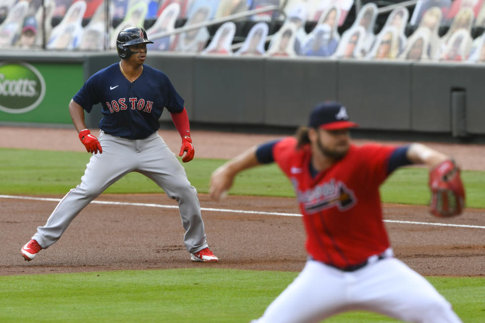 Boston Red Sox' Rafael Devers plays off first base as Atlanta Braves' Bryse Wilson pitches, after Devers hit a one-run RBI single to left field during the first inning of a baseball game Sunday, Sept. 27, 2020, in Atlanta. (AP Photo/John Amis)